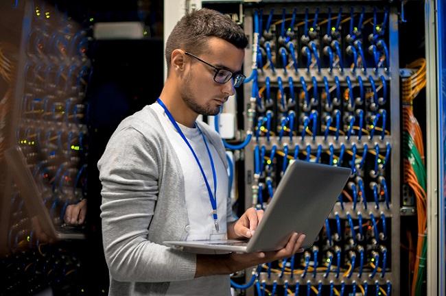 Man Managing Supercomputer Servers